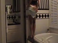 Slim slut gets recorded while erotically stripping