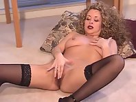 A sexy looking blonde Milf masturbates herself