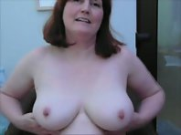 Sexy mature redhead wife rubbing her big tits on film