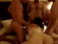 A brunette with a perfect ass is getting surrounded by cocks