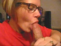 Bleached blonde suckles on a rock hard cock