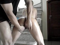 Oiled up hottie with a perfect ass gets fingered