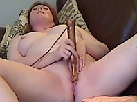 A red haired Milf ramming her chubby body with toys