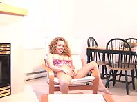 A curly haired blonde spreads her legs and masturbates hardcore